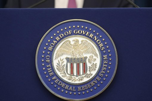 ФРС заявила, что будет удерживать процентные ставки около 0%